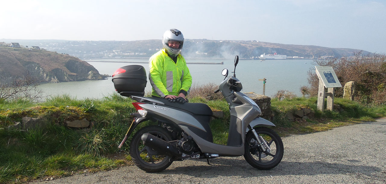Penslade with a Green Dragon Scooter